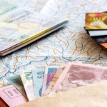 Living in a foreign country passport, currency, bank cards, and map flat lay