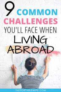 9 common challenges you'll face when living abroad - girl holding map against white wall