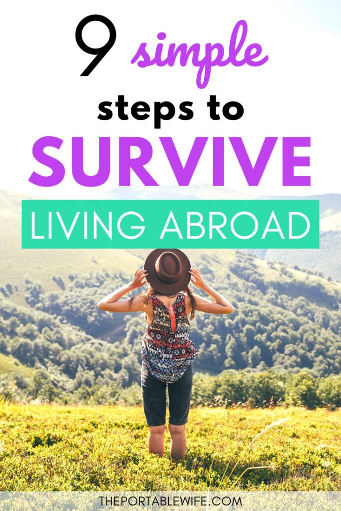 9 simple steps to survive living abroad - girl holding hat standing on grassy hill