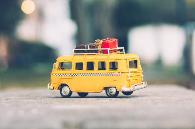 Mini yellow bus with luggage after learning how to declutter before moving abroad