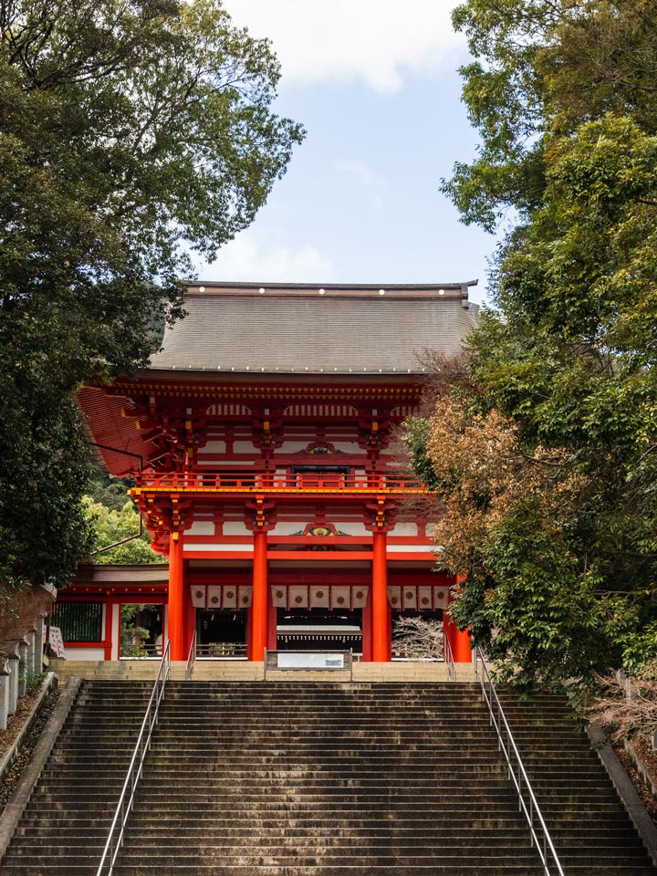 Red and white shrine gate at top of stairs