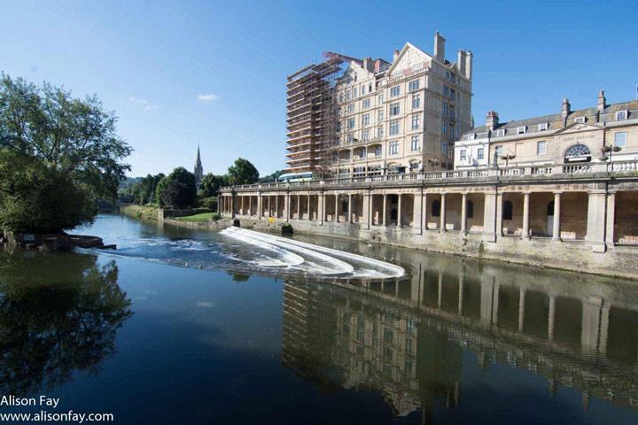 View of Roman Bath building along riverfront