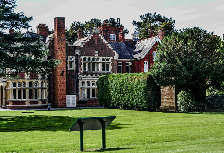 Brick front facade of Bletchley Park building with front garden