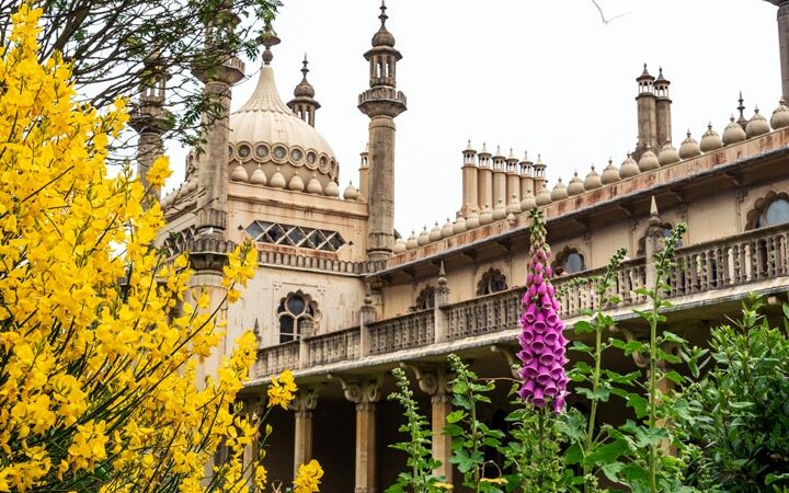Brighton Royal Pavilion with yellow and purple flower garden, one of the best easy day trips from London by train