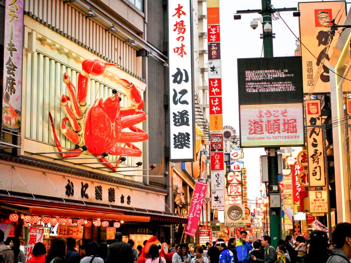 Osaka Dotonbori Street during busy afternoon with view of famous crab
