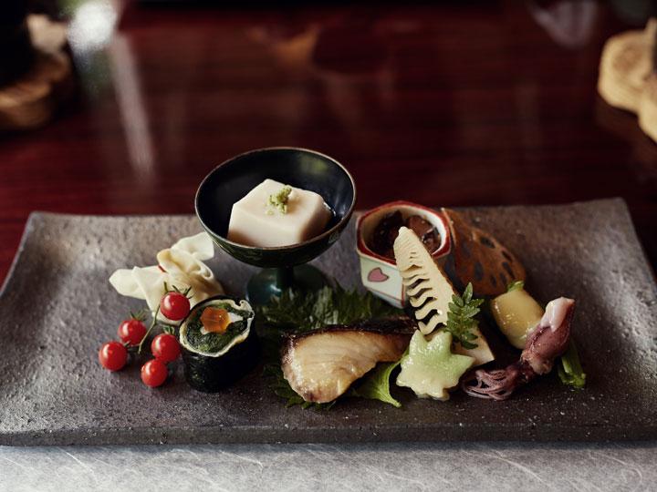 Assortment of Japanese dishes on platter for kaiseki meal