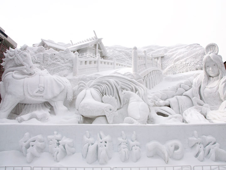 Elaborate snow sculpture of animals and castle at Sapporo Snow Festival