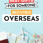 "Flat lay of passports, map, plane, and money, with text overlay - ""34 best gifts for someone moving overseas""."