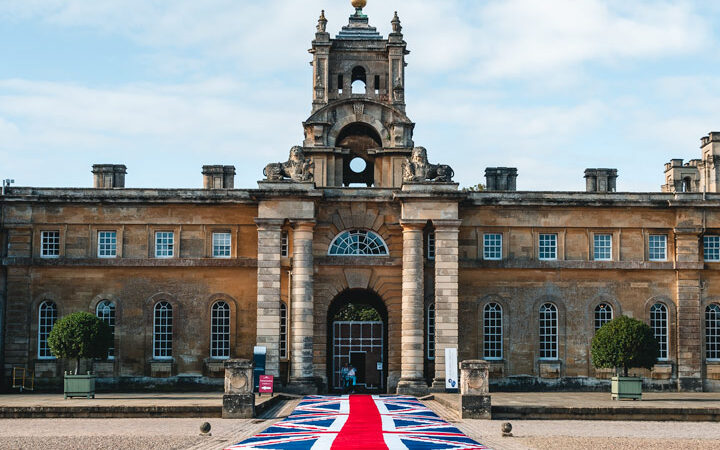 Blenheim Palace grand entrance with Union Jack flag runner leading to gate