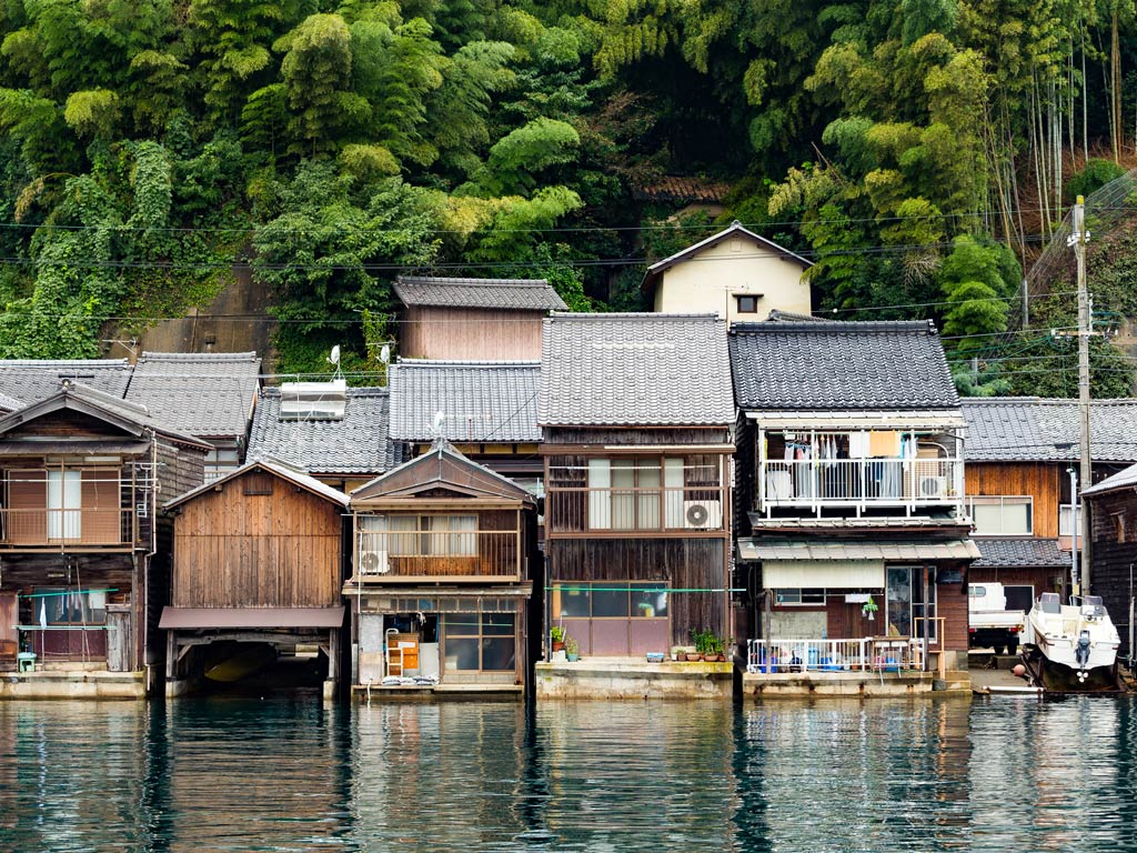 Wooden facades of fisherman's houses in Funaya, an easy day trip from Kyoto