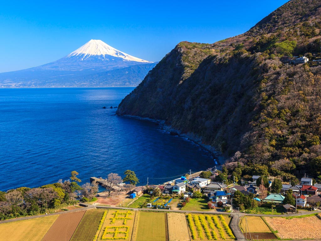 Bayside view of Mount Fuji and small farming village in Japan off the beaten path