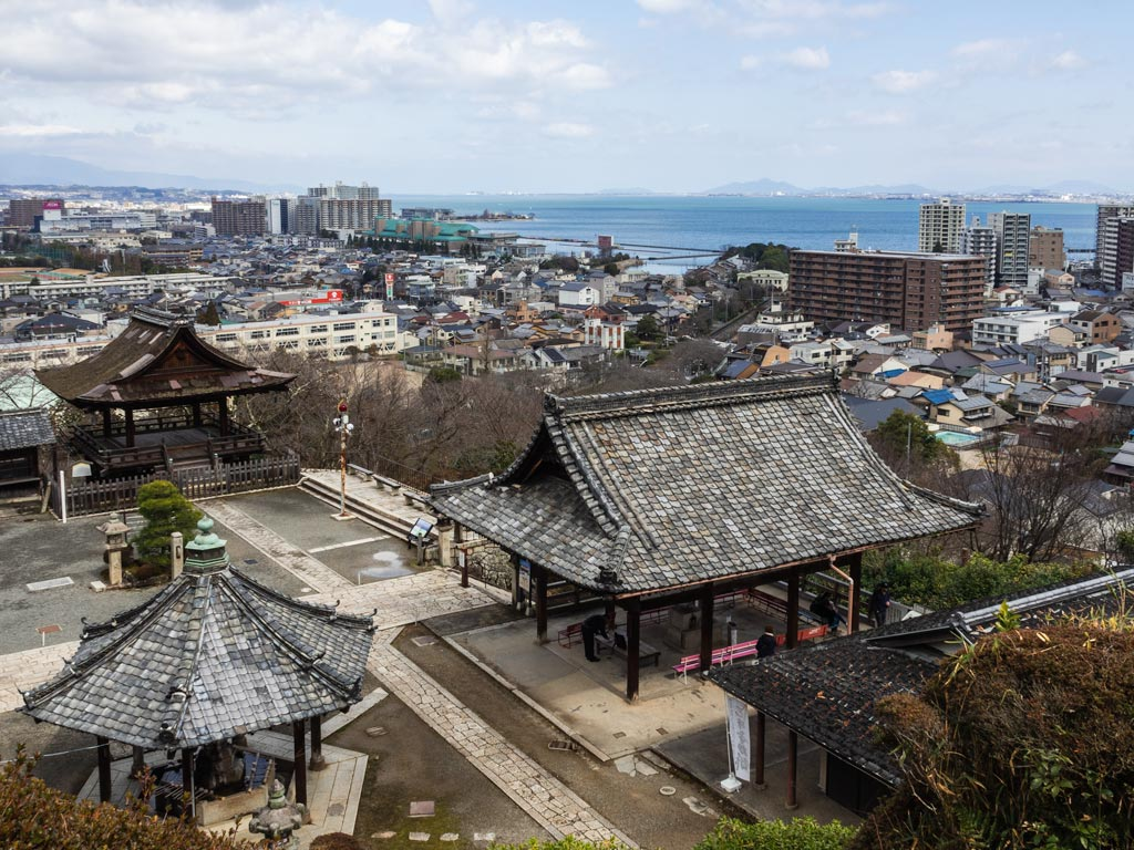 View of Mii-dera temple complex and city with Lake Biwa in distance