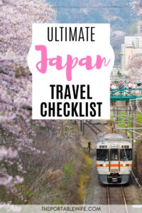 Ultimate Japan Travel Checklist - train with cherry blossoms around track