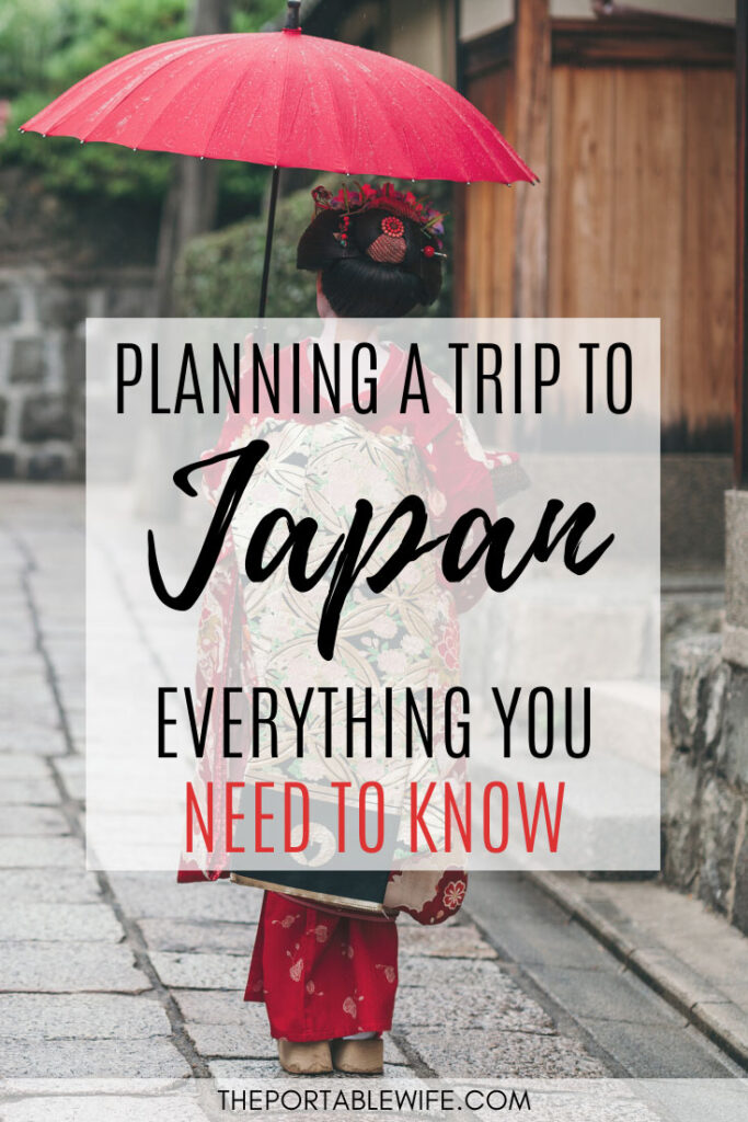 Planning a trip to Japan: Everything you need to know - Geisha holding red umbrella walking down street