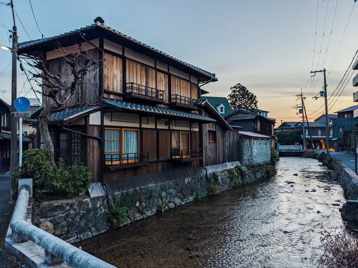 Traditional wooden Japanese house on canal in Kyoto