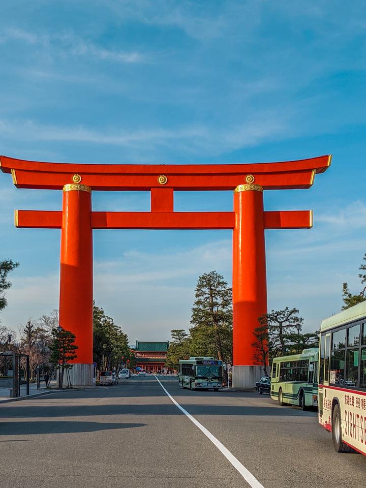 Giant orange torii gate over Kyoto street