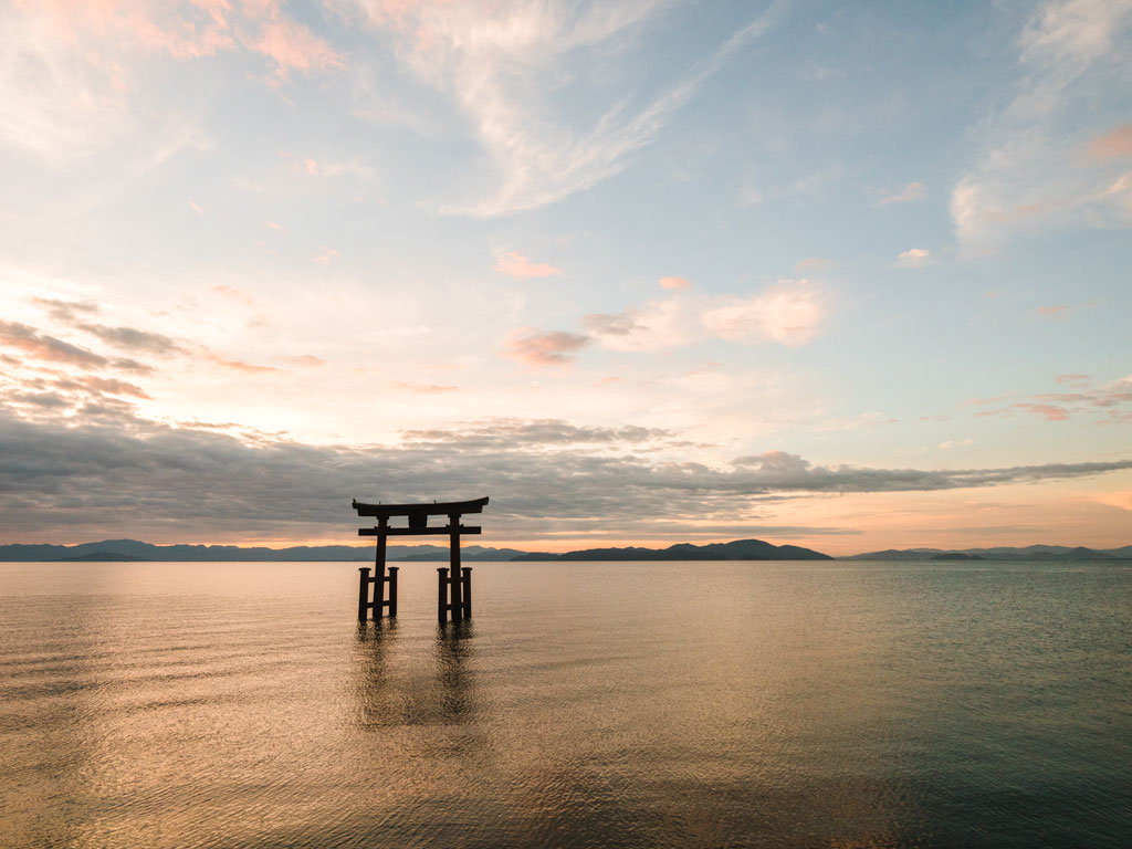 Floating torii gate at sunrise, a popular place to visit during a Lake Biwa day trip
