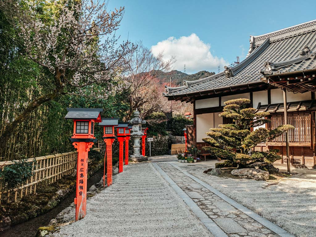Japanese shrine with pebble landscape and orange lanterns in Lake Biwa Japan
