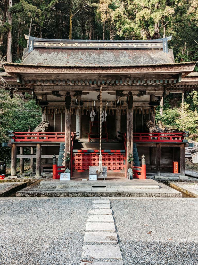 Old wooden shrine with interior bell and red details
