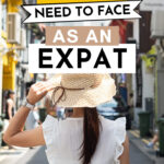 """Girl in white dress and straw hat walking down alley, with text overlay - """"7 Truths You Need to Face As An Expat."""""""