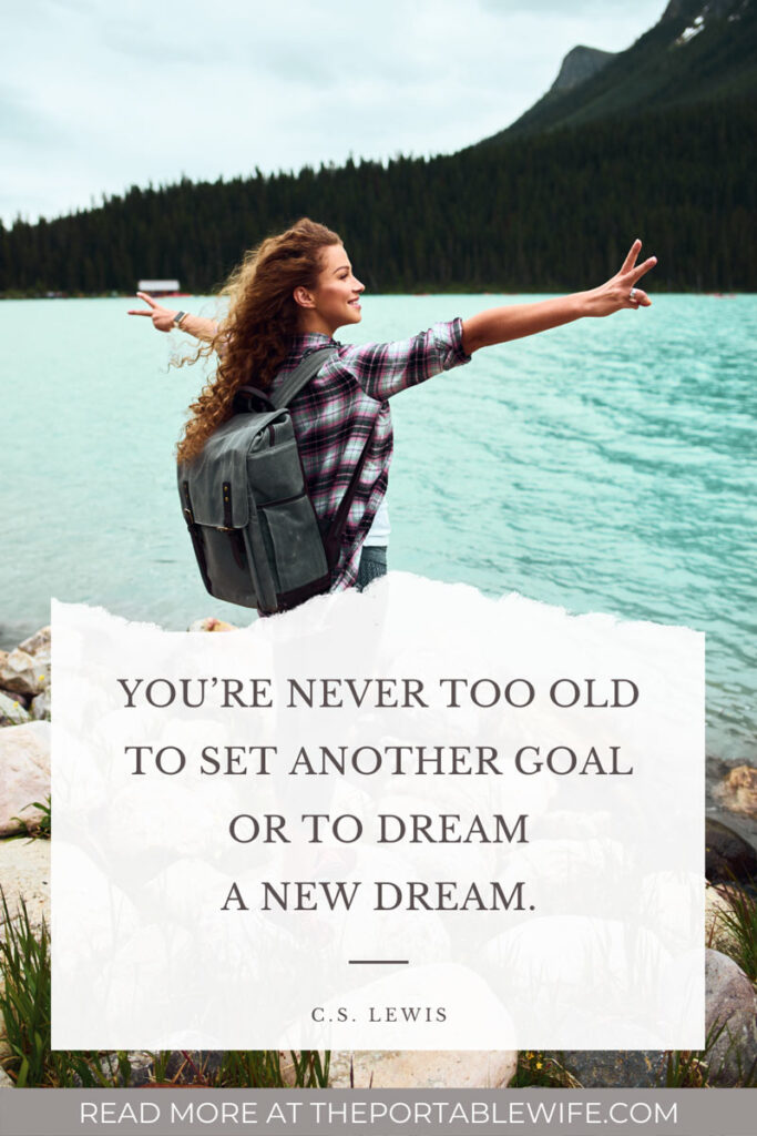 "Living abroad quotes overlay - ""You're never too old to set another goal or to dream a new dream"" - Girl standing in front of blue lake"