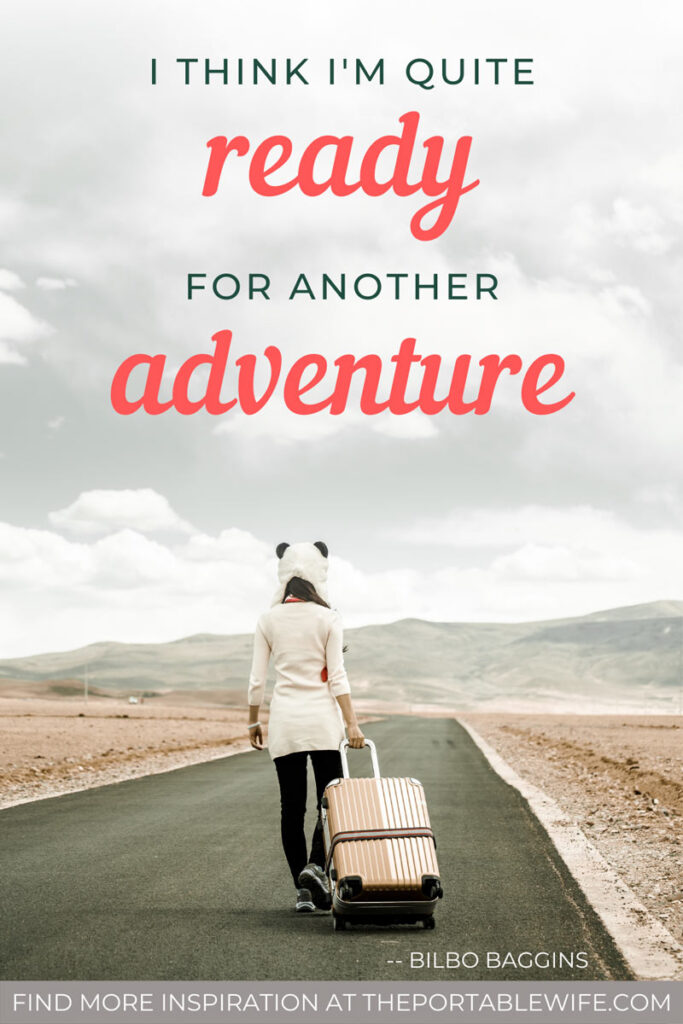 Text overlay: I think I'm ready for another adventure - Girl walking down empty road with white suitcase