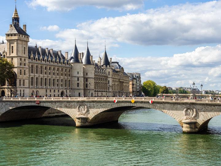 Stone bridge across Seine River in Paris