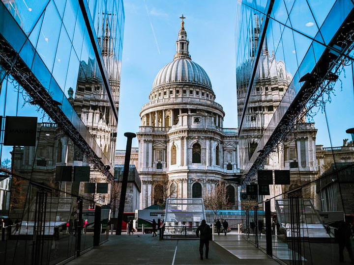 London St. Paul's Cathedral viewed from alley with glass walls reflecting building