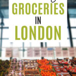 How to buy groceries in London - London grocery store with baskets of fruit and window