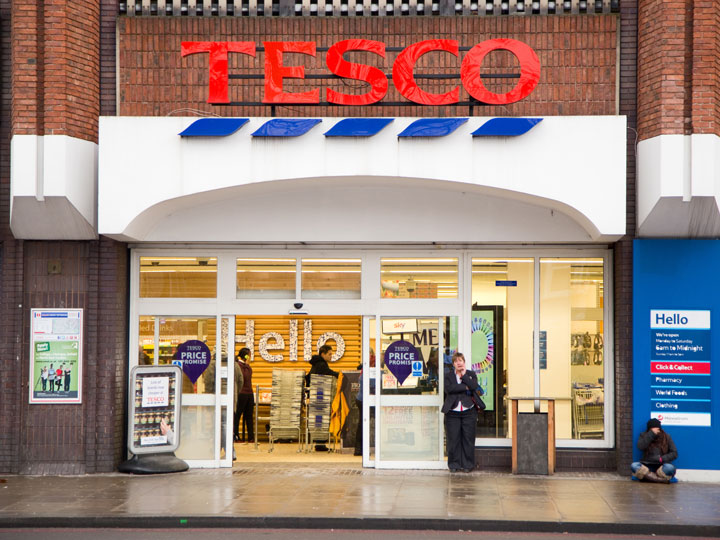 Front exterior doors of Tesco, the most popular of London grocery stores