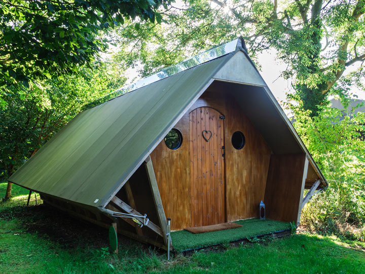 A-frame wood and metal cottage in forest for hen glamping weekends
