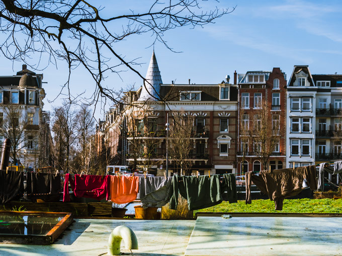 Colorful travel capsule wardrobe Europe hanging on clothesline
