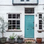 Monthly expenses in London - white London mews house with blue door