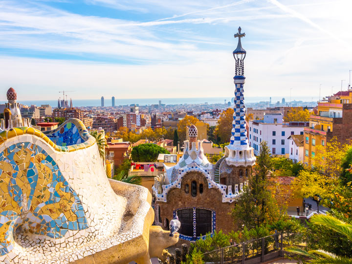View of Parc Guell Barcelona with blue and white tower in distance