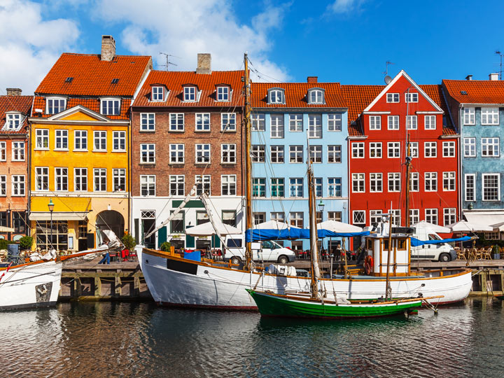 Colorful houses and boats on river of Copenhagen Nyhaven district