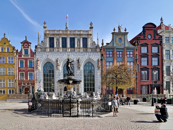 Gdansk town square with fountain and colorful buildings in background