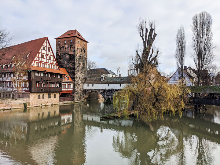 River, bridge, and half-timbered house in Nuremberg, one of the most Instagrammable places in Europe