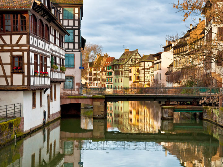 Strasbourg river view of bridge and half-timbered houses on either size