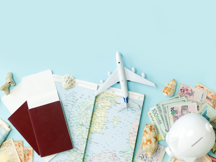 Moving abroad checklist concept with passports, map, money, and toy plane