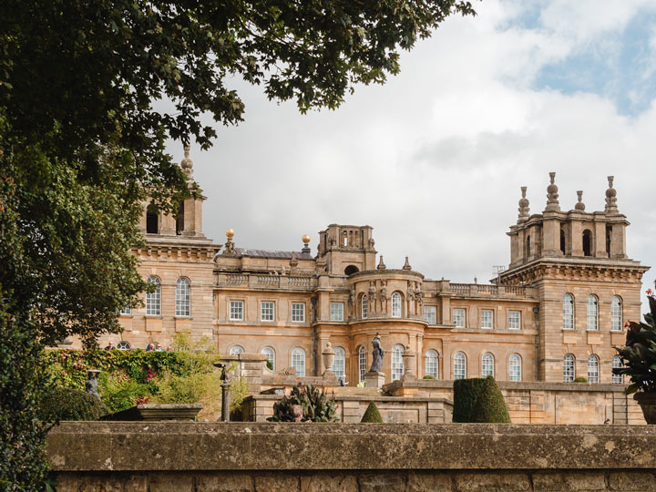 View of England's Blenheim Palace facade with numerous windows and turrets