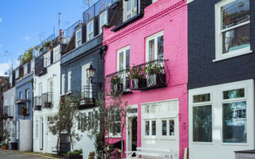 Pink and blue facades of St. Luke's Mews, a much requested neighborhood for London relocation agents