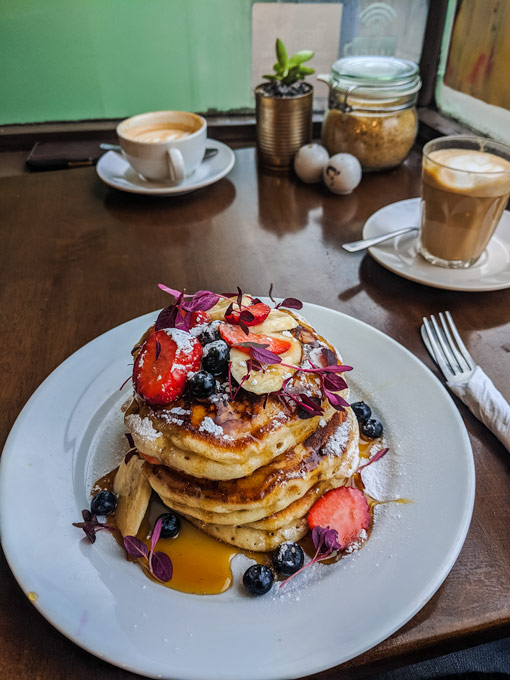 Stack of pancakes with fruit I ate during my first year living in London
