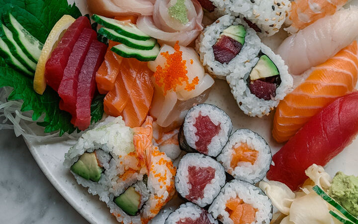Colorful plate of sushi rolls and nigiri, a must eat food in Japan