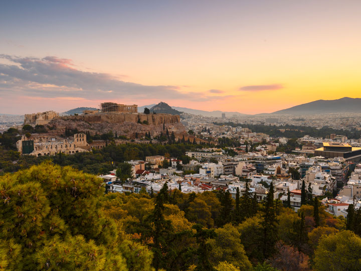 Sunset over Athens city with Acropolis in distance
