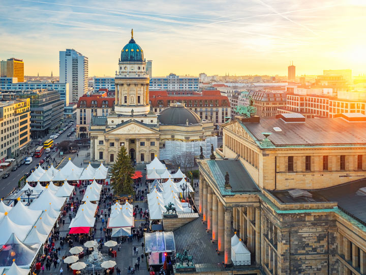 Sunrise over Berlin Christmas market and skyline