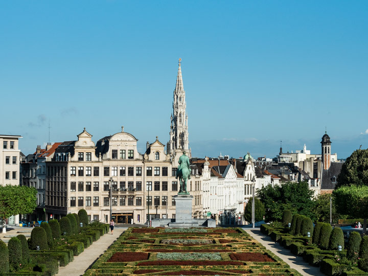 View of Brussels city from Mont Des Arts with garden and statue in foreground