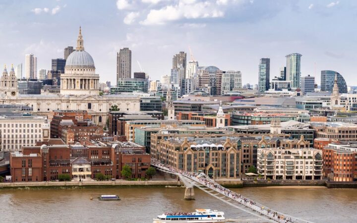 London skyline with river in foreground, one of the must see cities for first time in Europe