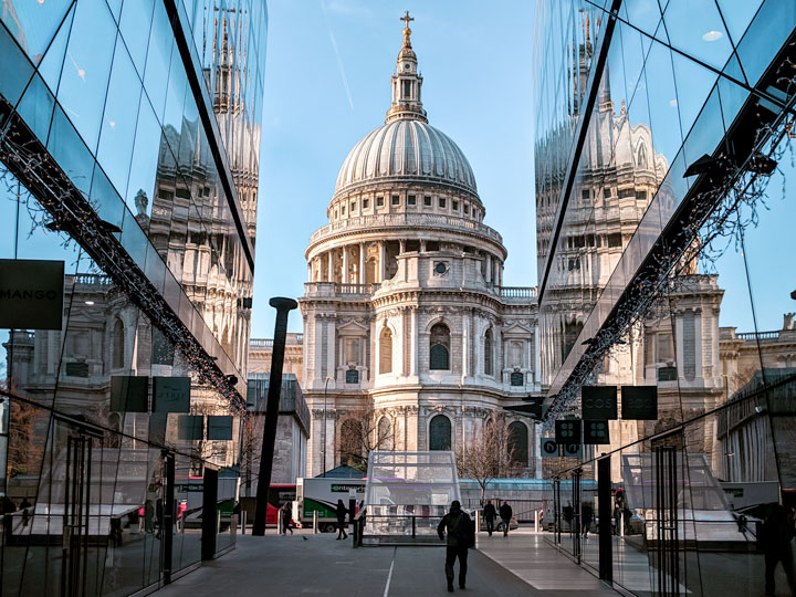 View of St. Pauls' Cathedral from alley with glass reflections