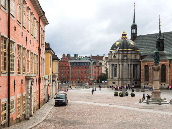 Stockholm pink and red buildings with domed church entrance in background