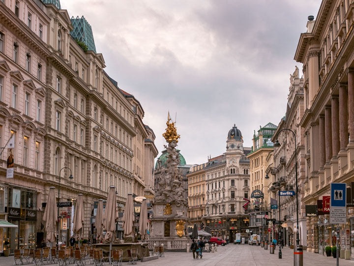 Vienna city center with tall buildings and gold statue in center